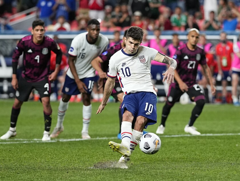 United States' Christian Pulisic (10) kicks a penalty kick for a goal against Mexico during extra time in the CONCACAF Nations League championship soccer match, Sunday, June 6, 2021, in Denver. (AP Photo/Jack Dempsey)