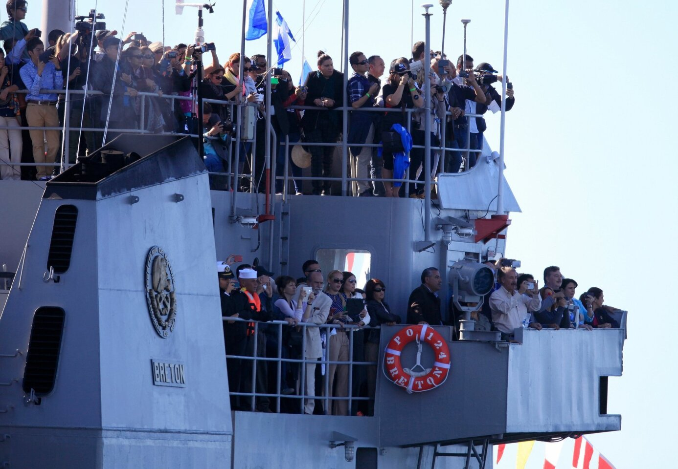 Spectators witness the sinking of the URIBE 121 former patrol vessel on Saturday from PO124 Breton off the coast of Rosarito Beach.
