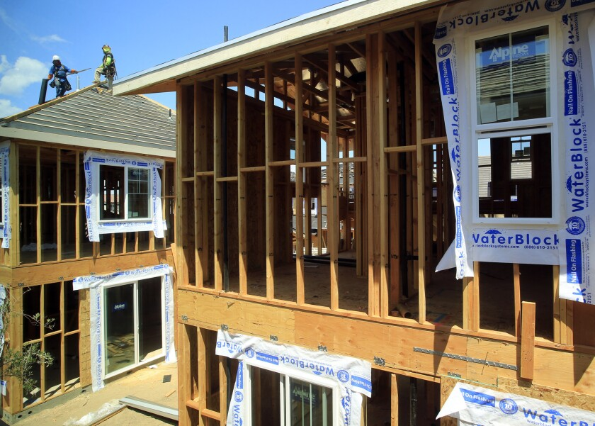New homes under construction last year in Irvine. A report out Tuesday from an Orange County business group says home building must accelerate to keep up with job growth in the region.