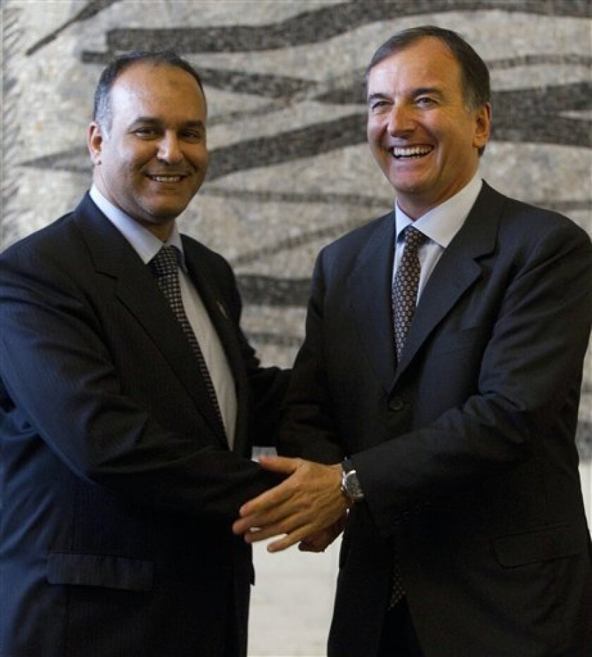 Libyan National Transitional Council's Foreign Minister Ali al-Essawi, left, and Italian Foreign Minister Franco Frattini, during a press conference, in Rome, Monday, April 4, 2011. Italy on Monday recognized the opposition Libyan National Transitional Council as the only legitimate voice in the north African nation, the Italian foreign minister said. Rome also dismissed a diplomatic push in Europe by Moammar Gadhafi's government to discuss an end to the fighting. Foreign Minister Franco Frattini said that any solution to the Libyan conflict involved the departure of Moammar Gadhafi and his family. (AP Photo/Andrew Medichini)