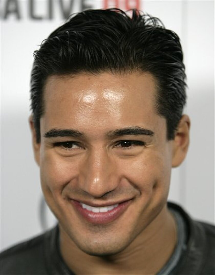 "In this Sept. 26, 2008 file photo, Mario Lopez arrives at the EA Sports ""NBA Live 09"" launch party in Los Angeles. (AP Photo/Matt Sayles, file)"