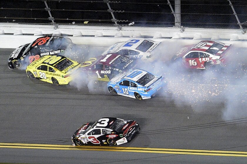 Martin Truex Jr. (78), Matt Kenseth (20), Jamie McMurray (1), Brad Keselowski (2), Danica Patrick (10) and Greg Biffle (16) collide on the final lap as Austin Dillon (3) drives past during the Sprint Unlimited auto race at Daytona International Speedway, Saturday, Feb. 13, 2016, in Daytona Beach, F