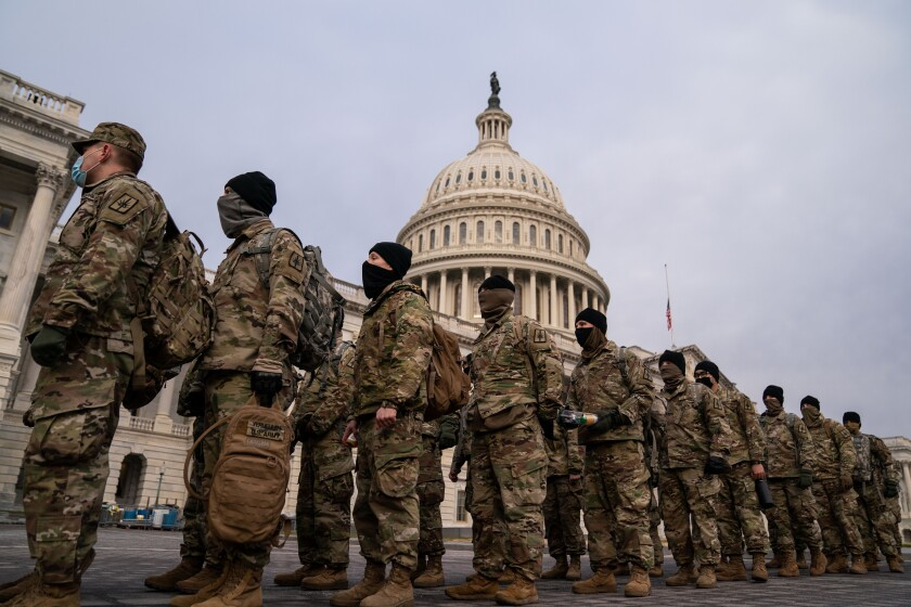National Guard members line up on the U.S. Capitol grounds Jan. 11.
