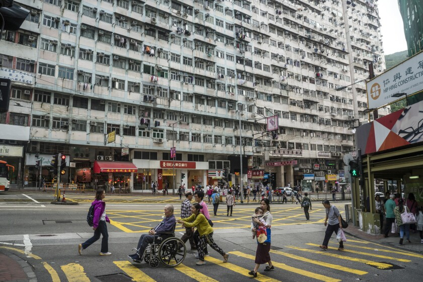 Pedestrians walk past public housing built in the 1960s in Quarry Bay, Hong Kong SAR on March 29th,