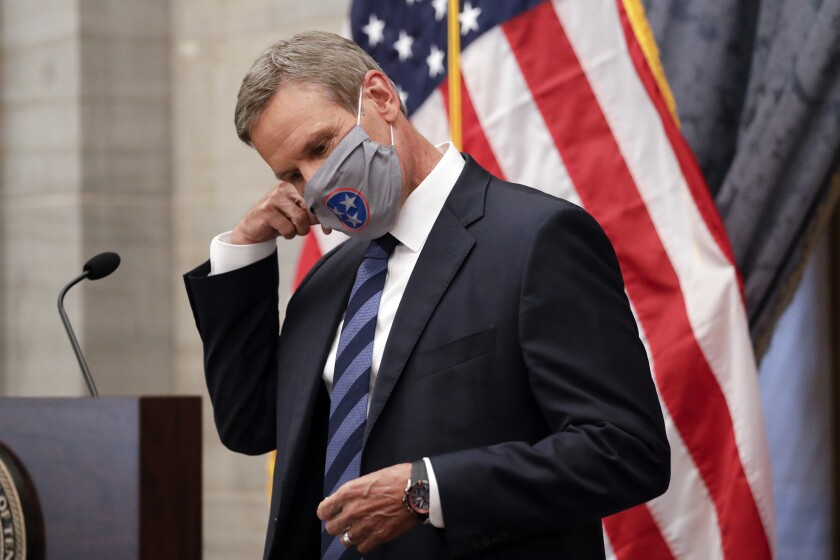 Tennessee Gov. Bill Lee removes his mask as he begins a news conference Wednesday, July 1, 2020, in Nashville, Tenn. (AP Photo/Mark Humphrey)