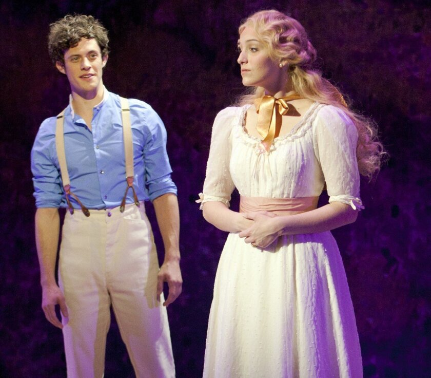 George Emerson (Kyle Harris) tries to woo Lucy Honeychurch (Ephie Aardema) in the musical 'A Room with a View' at The Old Globe Theatre. Photo by Henry DiRocco