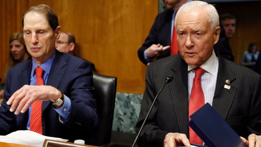 Sens. Ron Wyden (D-Ore.), left, and Orrin Hatch (R-Utah) reached an agreement last month to extend the Children's Health Insurance Program. Since then, there's been no legislative action and funding is running out in many states.