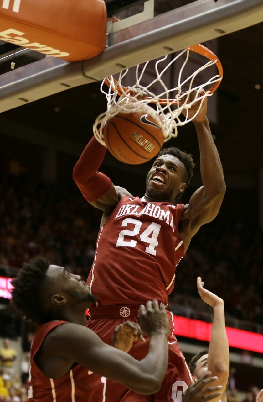 FILE - In this Jan. 18, 2016, file photo, Oklahoma guard Buddy Hield (24) dunks the ball during the first half of a college basketball game against Iowa State in Ames, Iowa. Buddy Hield had big expectations when he returned to Oklahoma for his senior season. Things have gone even better than expected. The sharpshooting guard has averaged 29.3 points in the NCAA Tournament heading into the Sooners' national semifinal Saturday against Villanova. (AP Photo/Charlie Neibergall, File)