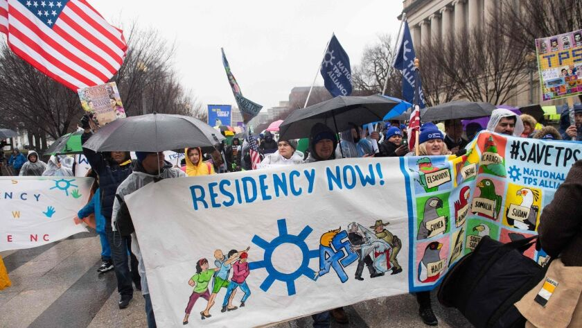 Demonstrators participate in the March for TPS Justice outside the White House in Washington on Feb. 12, 2019.