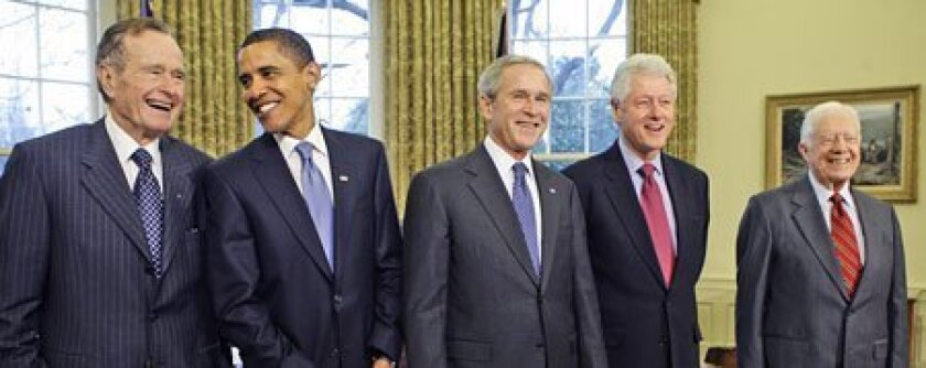 President-elect Barack Obama joined former President George H.W. Bush, President Bush and former Presidents Clinton and Carter in the Oval Office yesterday. The five men had a 90-minute luncheon in a small dining room off the Oval Office.  (Doug Mills / New York Times News Service)