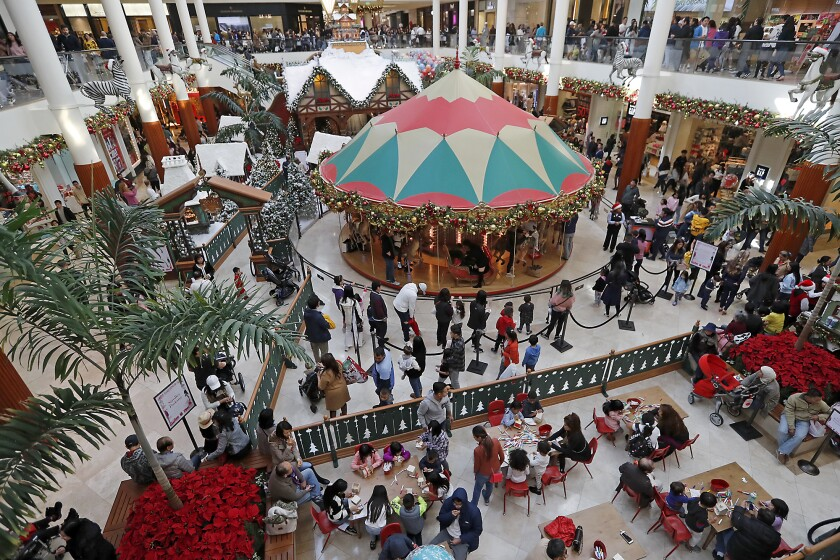 Shoppers fill South Coast Plaza's Carousel Court.