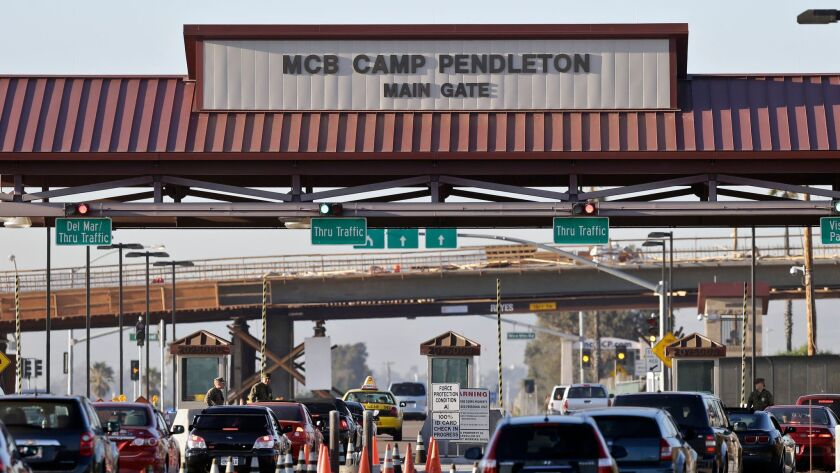FILE - This Nov. 13, 2013, file photo shows the main gate of Camp Pendleton Marine Base at Camp Pend