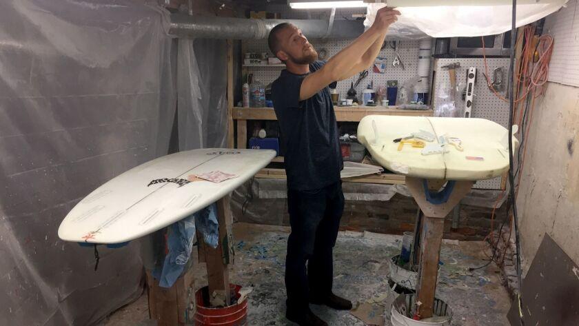Dan Setzke makes custom surfboards for surfing rivers.