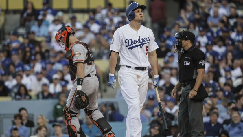 Dodgers shortstop Corey Seager appears frustrated after striking out against Giants pitcher Tony Watson in the eighth inning at Dodger Stadium.