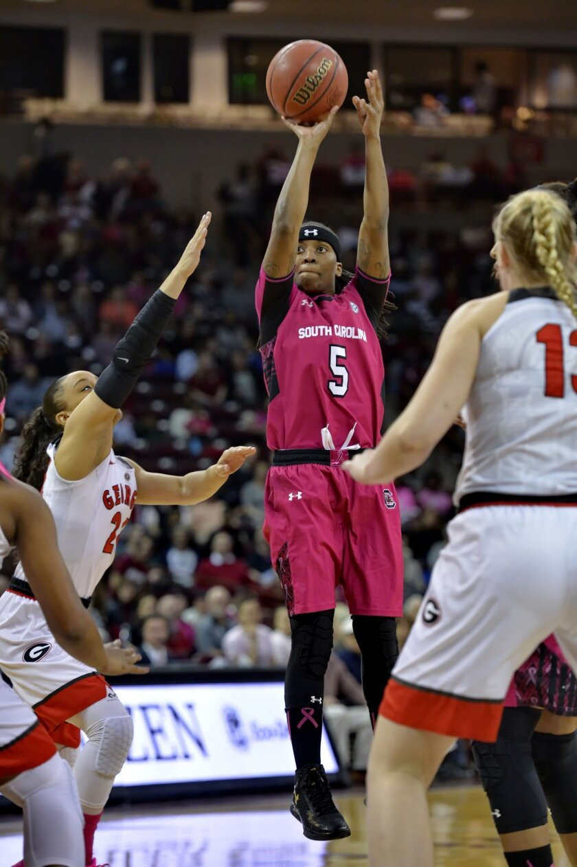 South Carolina's Khadijah Sessions shoots a 3-pointer during the first half of an NCAA college basketball game against Georgia on Thursday, Feb. 18, 2016,  in Columbia, S.C. (AP Photo/Richard Shiro)