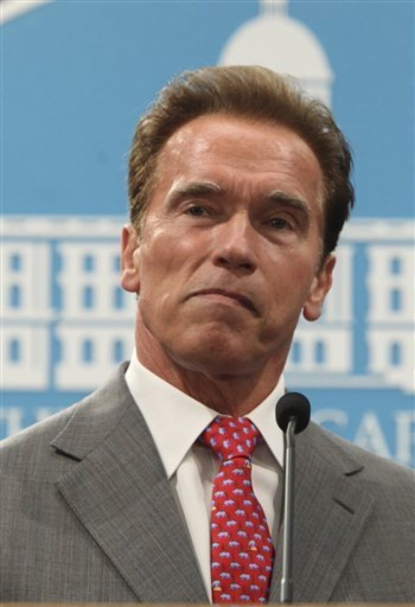 FILE - This July 1, 2009 shows Gov. Arnold Schwarzenegger listening to a question concerning his declaration of a fiscal emergency at a Capitol news conference in Sacramento, Calif. Lawmakers failed to solve the state's whopping $24.3 billion deficit by the start of the new fiscal year. That preven