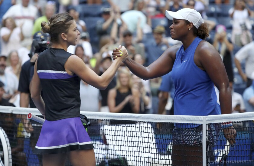Simona Halep, left, congratulates Taylor Townsend, who won their second-round match in the US Open tennis championships.