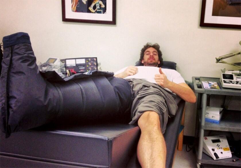 Pau Gasol receiving treatment for torn plantar fascia in his right foot.