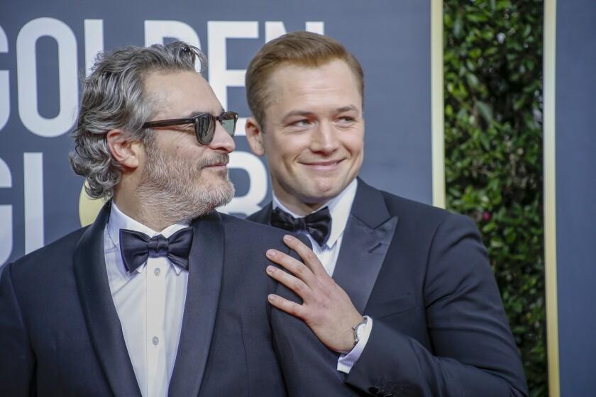 Joaquin Phoenix, left, and Taron Egerton at the Golden Globes 2020