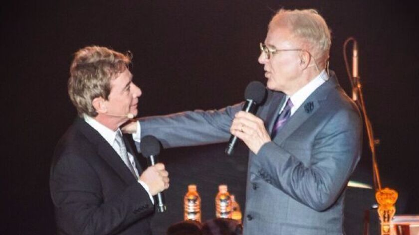 """in private, we're trying to make each other laugh,"" says Martin Short (left) of Steve Martin (right"
