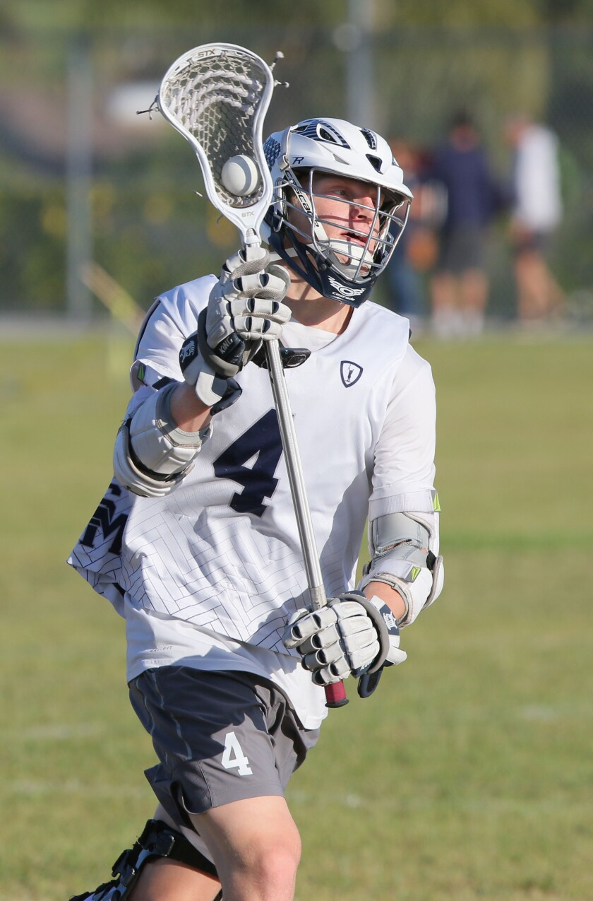 San Marcos High School lacrosse player Will Hauri is about to pass the ball during practice.
