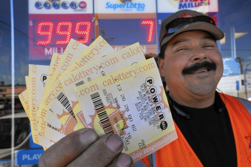 Edward Calderon, 50, of Wilmington holds $20 worth of Powerball tickets that he bought at Mr. C's Liquor in San Pedro.
