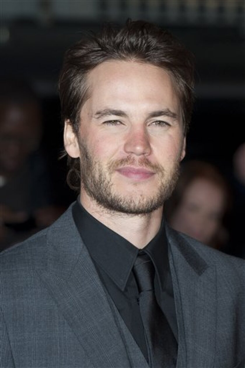 In this Thursday, March 1, 2012 file photo, Taylor Kitsch arrives for the UK premiere of John Carter at a central London venue. A Philippine official said Kitsch was not hassled at Manila's airport recently, as the Canadian actor indicated this week. (AP Photo/Jonathan Short, File)