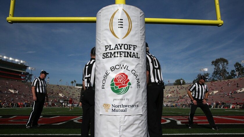 Referees prepare before a College Football Playoff semifinal game at the Rose Bowl.