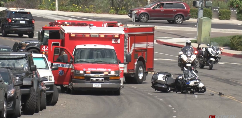 A San Diego police motorcycle officer was hospitalized after being hit by a vehicle
