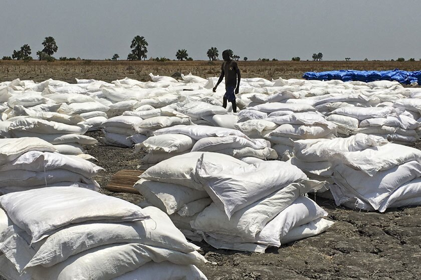 Bags of food dropped by air from a World Food Program plane are sorted in Padeah, South Sudan.