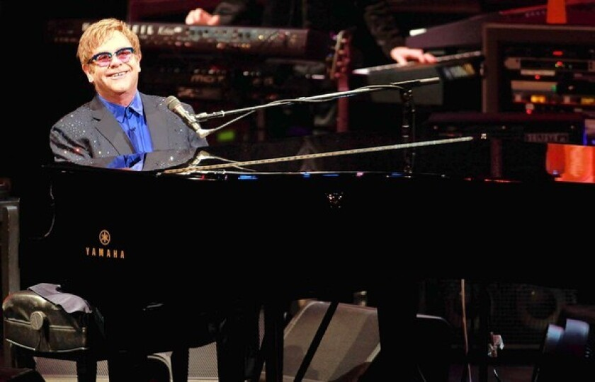 """Elton John performs old and new material, including songs from his new album """"The Diving Board,"""" with USC Thornton School of Music students at Bovard Auditorium."""
