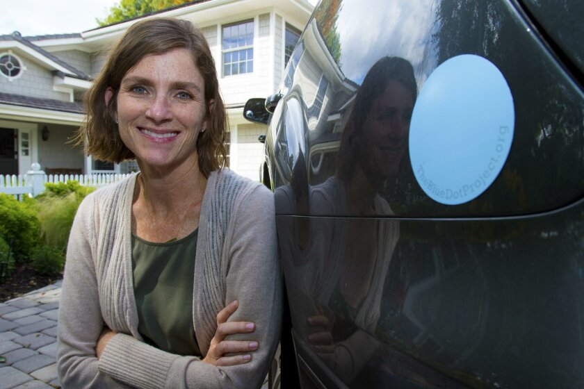 Peggy O'Neil Nosti is an Escondido mom who three years ago created the Blue Dot Project, a fundraising campaign of magnetic blue circles that people could put on their car bumpers in support of maternal mental health.