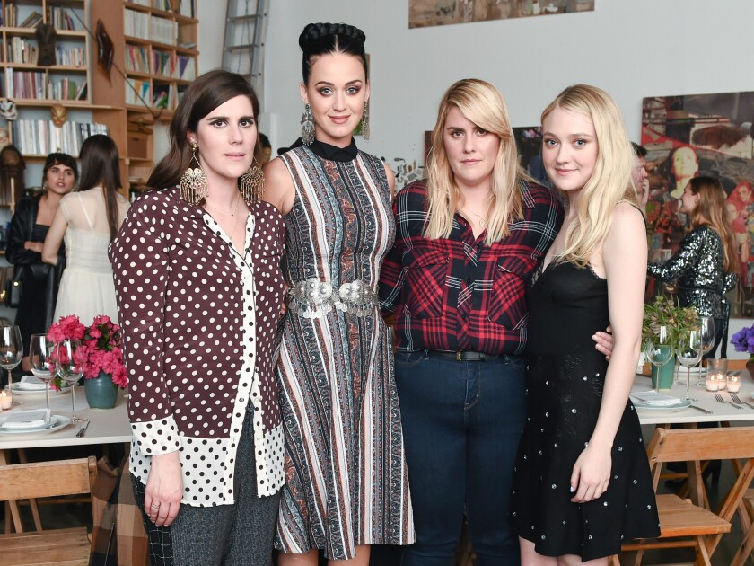 From left, Laura Mulleavy, Katy Perry, Kate Mulleavy and Dakota Fanning attend a March 14 dinner in downtown L.A. celebrating Rodarte's collaboration with Swedish label & Other Stories.
