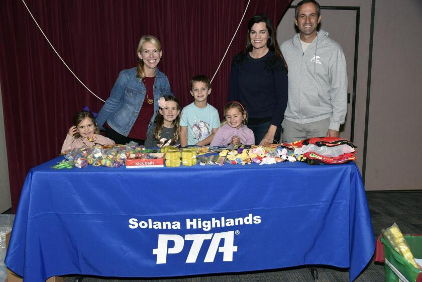PTA Committee member Kristina McGovern with Kinley and Madison, PTA event chair Juliet Torykian with John and Elle, Principal Matthew Frumovitz