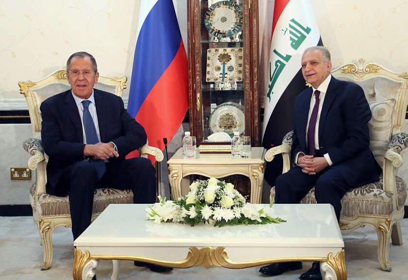 Iraqi Foreign Minister Mohamed Alhakim, right, meets with his visiting Russian counterpart Sergey Lavrov at the Ministry of Foreign Affairs in Baghdad, Iraq, Monday, Oct. 7, 2019. (AP Photo/Hadi Mizban)