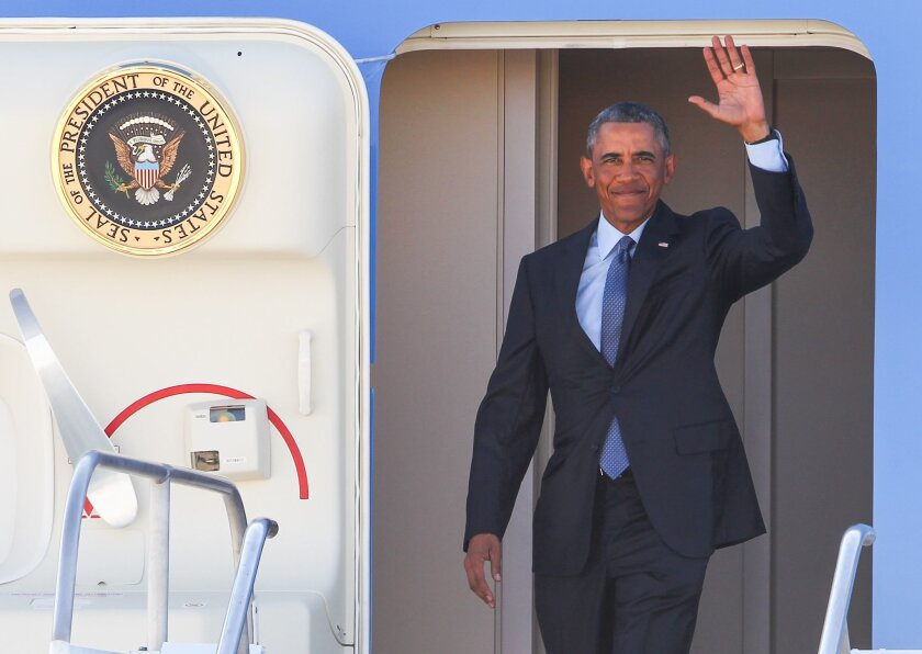 President Barack Obama waves while exiting Air Force One upon his arrival at McCarran International Airport, Monday, Aug. 24, 2015, in Las Vegas. Obama traveled to Nevada to speak at the National Clean Energy Summit in Las Vegas and later to a private event for the Nevada State Democratic Party at a residence in Henderson, Nev. (AP Photo/Chase Stevens)