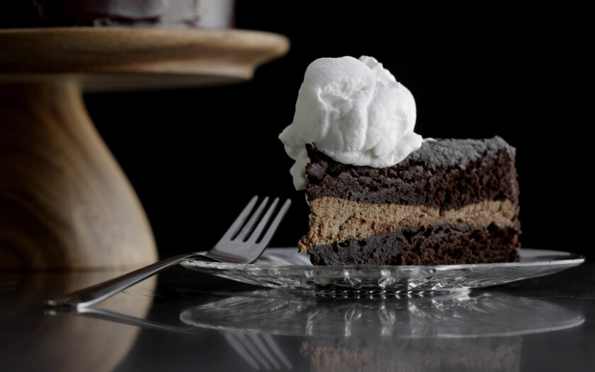 A delicious, gluten-free (not flourless) chocolate layer cake is made with buckwheat flour. In between the layers is a milk chocolate ganache, and covering the whole thing is a bittersweet chocolate glaze. Served with slightly sweetened crème fraîche. $55 for a 9-inch cake.