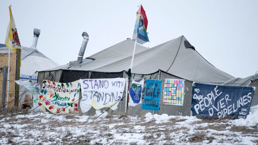 Signs of protest at the Oceti Sakowin Camp last month on the edge of North Dakota's Cannonball River, near the Standing Rock Sioux Reservation.