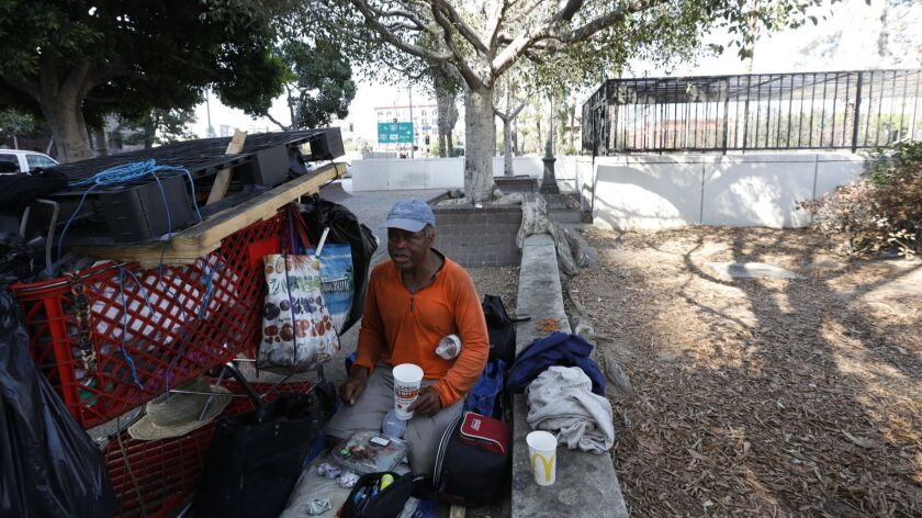 Alvaron Morrow, 57, rests outside the former Los Angeles Children's Museum downtown. The city is considering converting the site into crisis housing for homeless people.