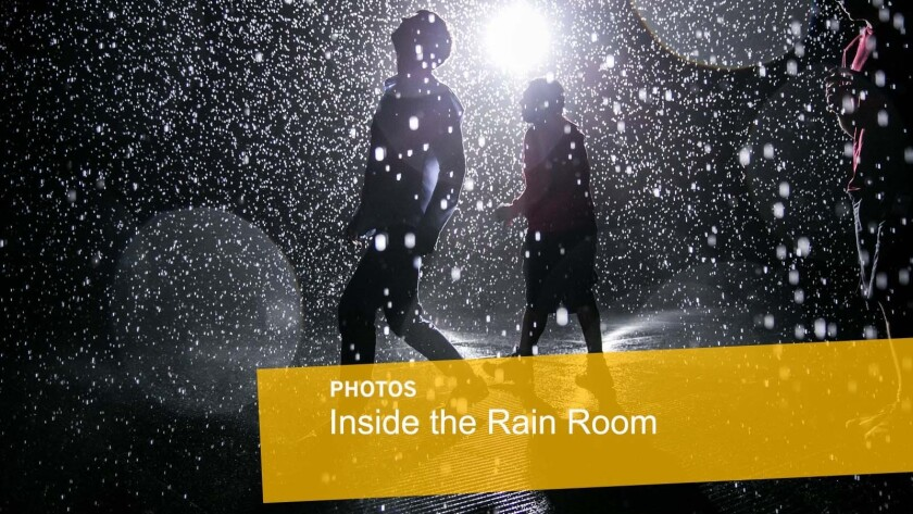 Dev Joshi, left, and Tom Stacey inside the newly assembled Rain Room, which will be on exhibit at LACMA.