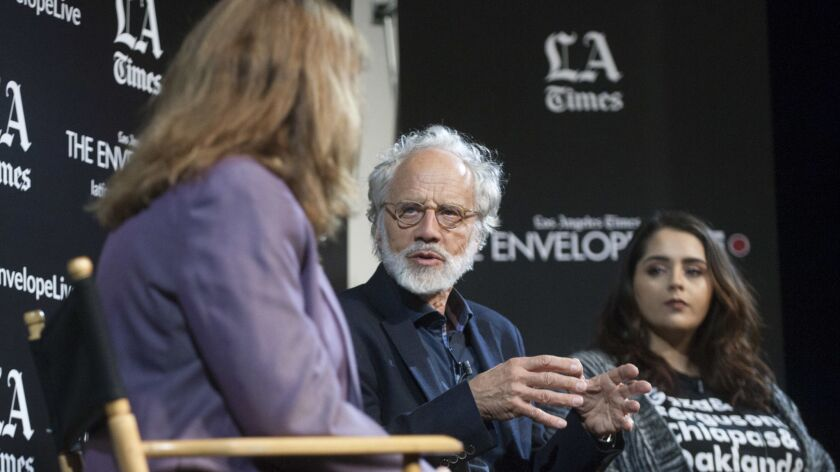 """""""Eldorado"""" director Markus Imhoof, center, with Los Angles Times critic Lorraine Ali, left, and Muna Sharif of Amnesty International, right, at the LA Times Envelope Live screening at the Montalban."""