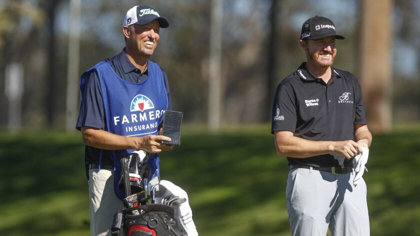 """Veteran caddy Jim """"Bones"""" Mackay, left, talks to Jimmy Walker on Friday during the second round of the Farmers Insurance Open. The last time Mackay caddied for someone other than Phil Mickelson at Torrey Pines was 1990."""