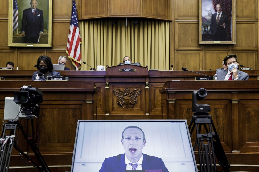 FILE - In this July 29, 2020, file photo, Facebook CEO Mark Zuckerberg speaks via video conference during a House Judiciary subcommittee hearing on antitrust on Capitol Hill in Washington. Federal regulators asked Wednesday, Dec. 9, 2020, for Facebook to be ordered to divest its Instagram and WhatsApp messaging services as the U.S. government and 48 states and districts accused the company of abusing its market power in social networking to crush smaller competitors. The antitrust lawsuits were announced by the Federal Trade Commission and New York Attorney General Letitia James. (Graeme Jennings/Washington Examiner via AP, Pool, File)