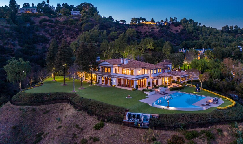 The 21,000-square-foot home sits on 3.5 acres with views of the city below.