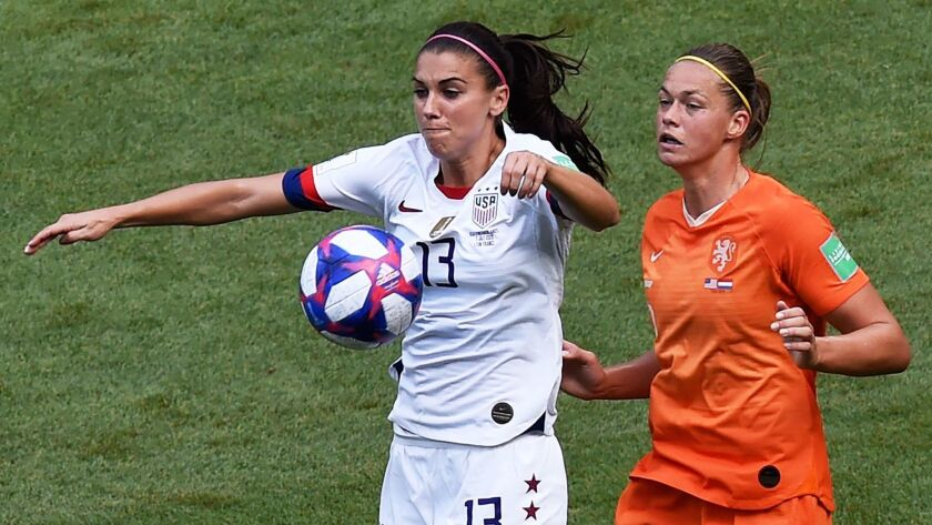 U.S. forward Alex Morgan, left, and Netherlands' defender Anouk Dekker battle for the ball during the first half of the Women's World Cup final on Sunday.