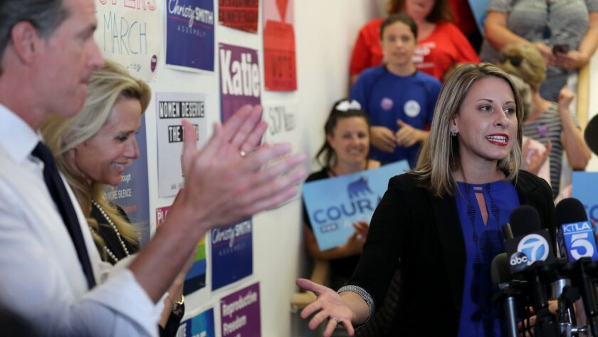 Democratic congressional candidate Katie Hill, right, speaks at a campaign rally Monday in Santa Clarita. She opposes the Republican tax cuts, which were supported by her opponent, incumbent Rep. Steve Knight (R-Palmdale).