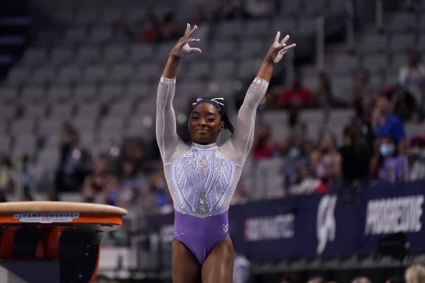 Simone Biles competes in the vault exercise during the U.S. Gymnastics Championships, Friday, June 4, 2021, in Fort Worth, Texas. (AP Photo/Tony Gutierrez)
