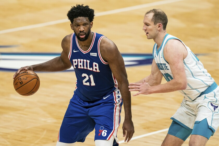 Philadelphia 76ers center Joel Embiid (21) is guarded Charlotte Hornets center Cody Zeller (40) during the first half of an NBA basketball game in Charlotte, N.C., Wednesday, Feb. 3, 2021. (AP Photo/Jacob Kupferman)