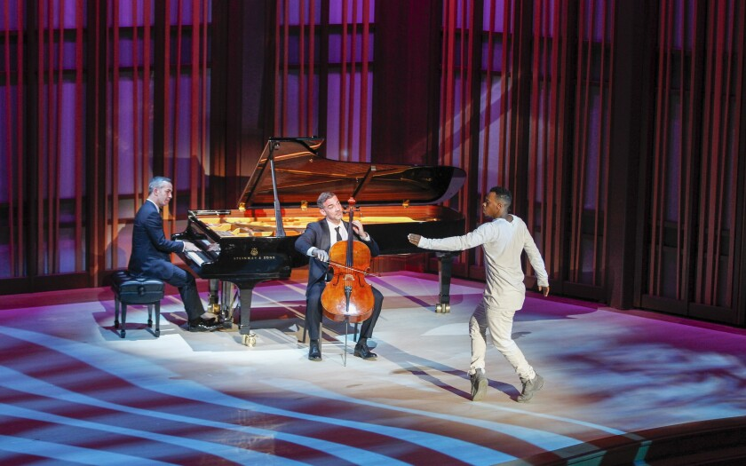 "Pianist Inon Barnatan (left), cellist Joshua Gindele (center) and dancer Charles "" Lil Buck"" Riley perform ""The Swan"" from Camille Saint-Saëns's ""The Carnival of the Animals"" at Friday's gala opening concert of the La Jolla Music Society's $82 million Conrad Prebys Performing Arts Center. Barnatan returns for an April 11 concert at The Conrad with the San Diego Symphony String Quartet."