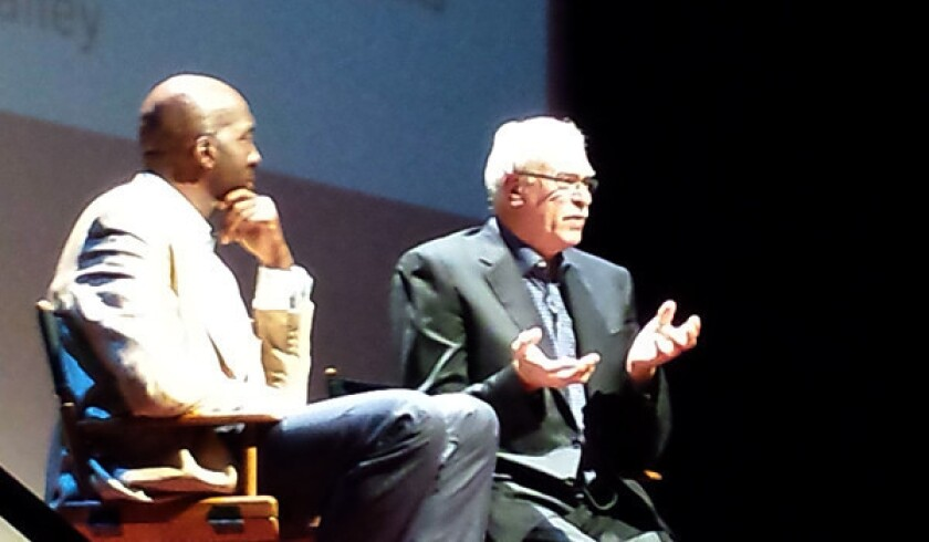 """Former Lakers Coach Phil Jackson, right, told an audience at """"Live Talks Los Angeles"""" that sometimes he feels he can get back on the court and lead a team, but """"the reality is I'm kidding myself."""""""